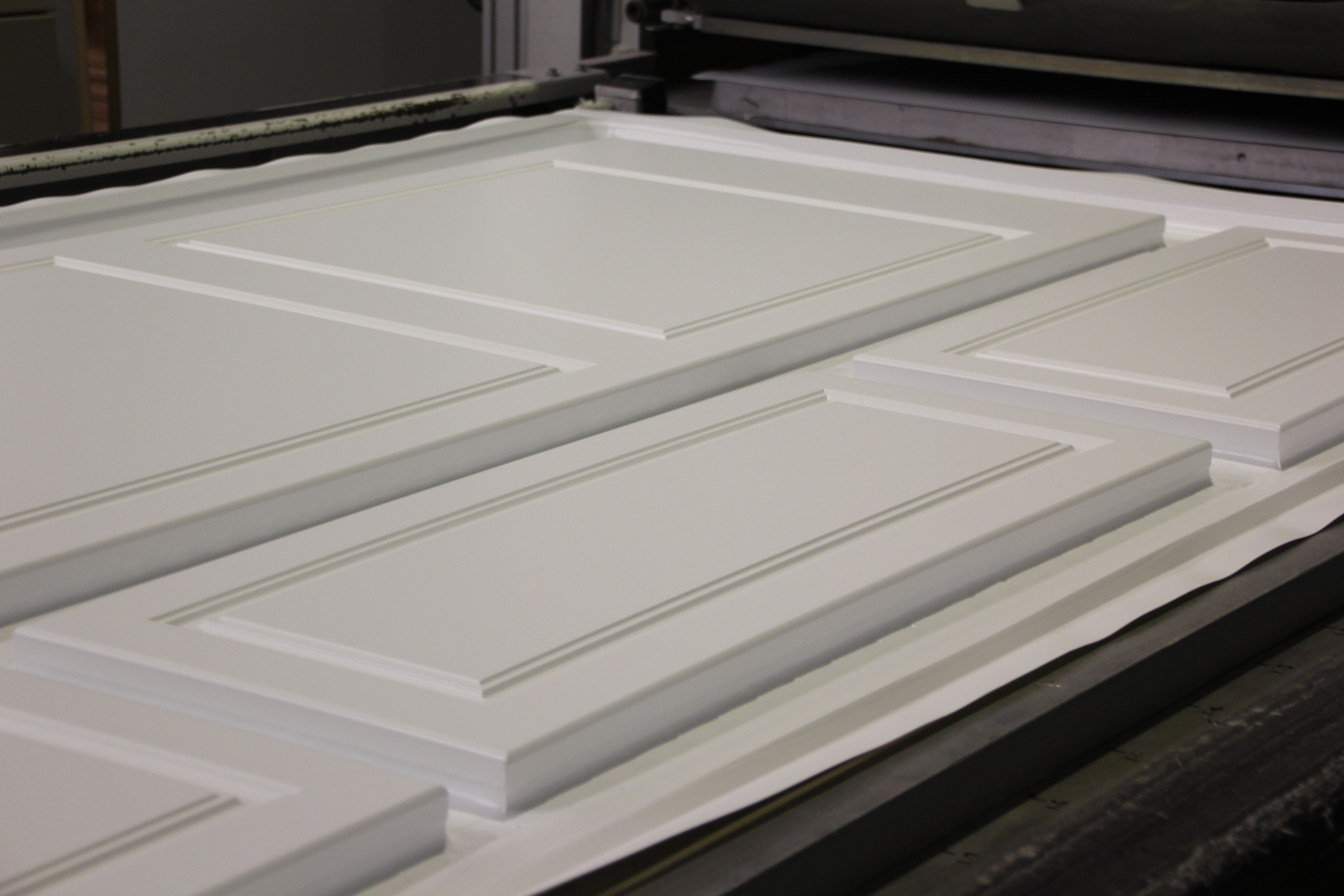 Tray full of just laminated wrapped doors.