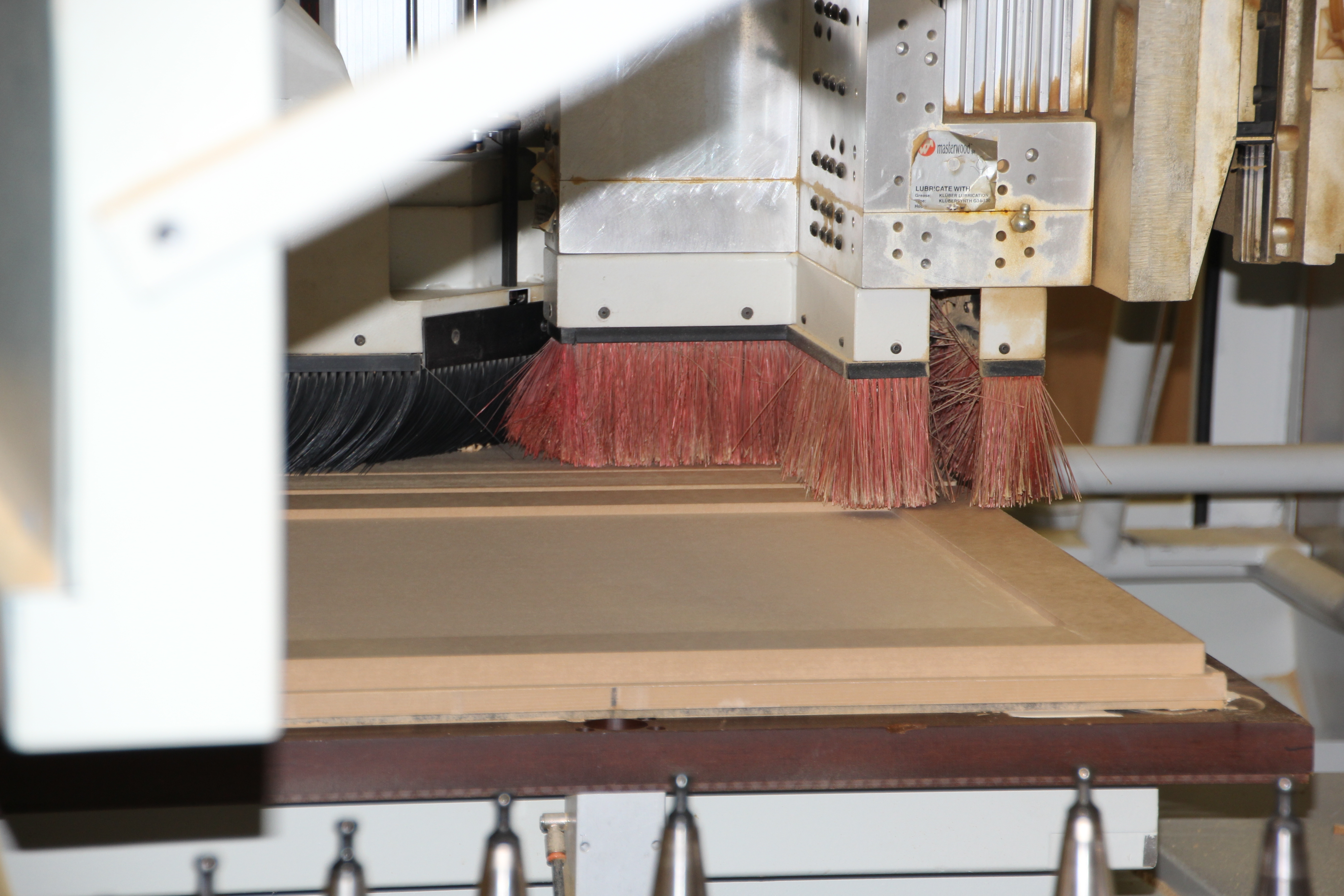 CNC Router carving out material to produce a door